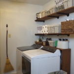Farmhouse laundry room with industrial shelving.