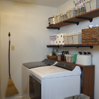 Farmhouse Laundry Room with Wooden Industrial Shelving and Baskets